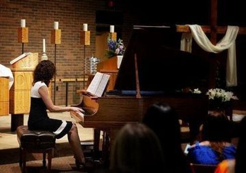 Jenna at the piano.jpeg