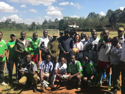 The Huruma Slum Men's Football Team play a football match to celebrate the donations of boots they received. - 2017