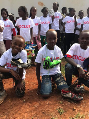 The EDCLUB boys and girls recieving the donations of boots - 2017