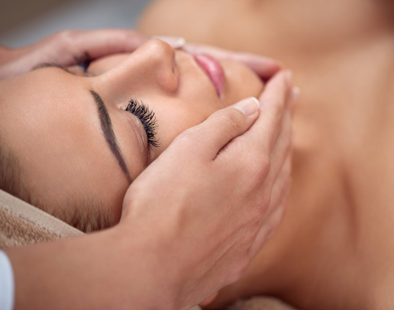 Close-up of a young woman getting spa tr