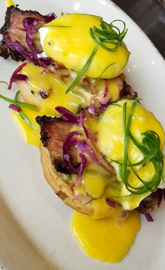 Smoked Brisket Benny: High Rise Biscuit, Poached Eggs, Red Cabbage Slaw, Anaheim Chili, Dill Pickle & Hollandaise