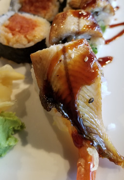 Dragon with Fresh Water Eel and Shrimp Tempura and Avocado and Cucumber with Spicy Mayo and Eel Sauce
