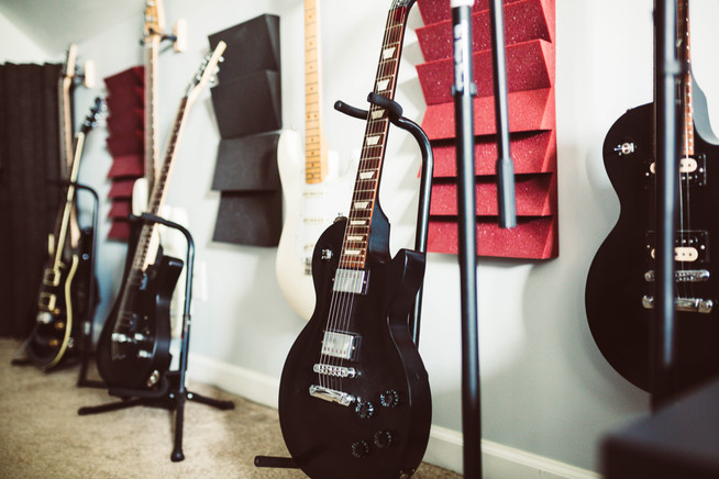 Gibson electric guitars and Fender Bass