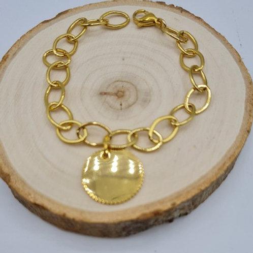 Bracelet en acier inoxydable doré et médaille crantée