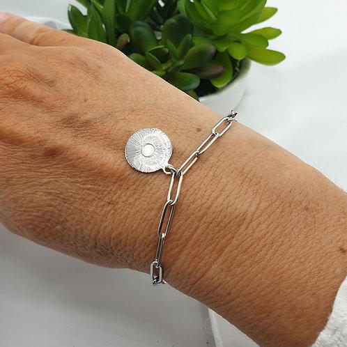 Bracelet en acier inoxydable et médaille rayons