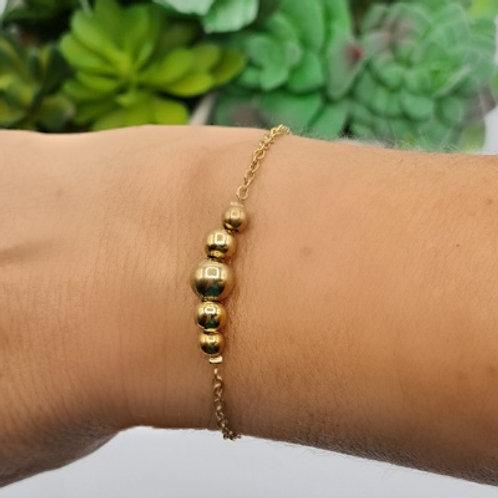 Bracelet en acier inoxydable doré 5 boules