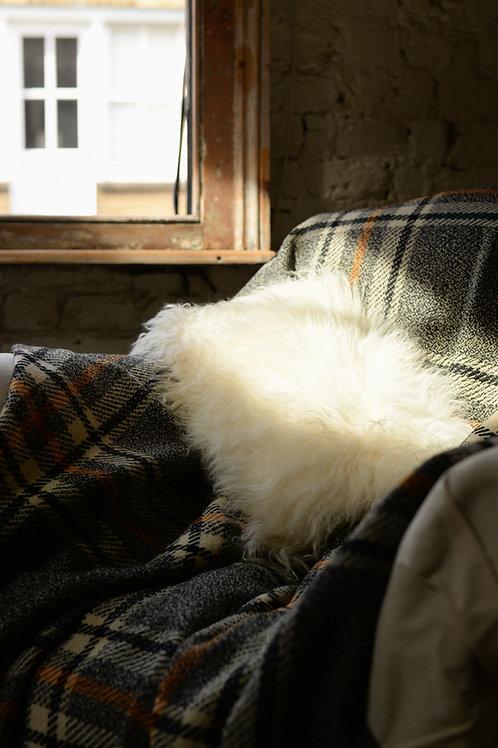 White sheepskin cushion