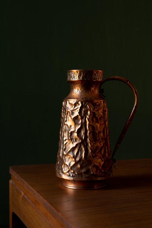 Brutalist copper pitcher