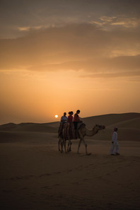 photography-of-people-riding-camel-durin