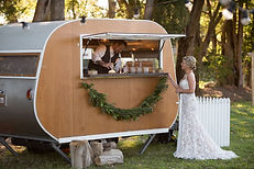Our bride being served champagne from our mobile bar.