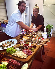 Setting up our cocktail canape platters with a smile