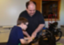 Trustee Rob Lomascolo printing with a student