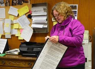 Volunteer Linda Albrecht working on the new CLNB exhibit