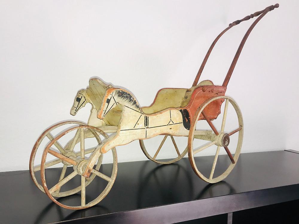 Handmade horse-drawn doll buggy, Iowa 1877
