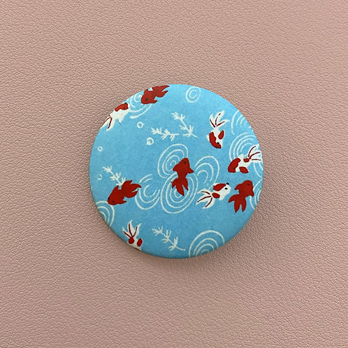 Badge Poissons Rouges