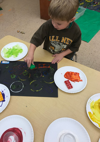 Exploring with shapes and paint. (3's)