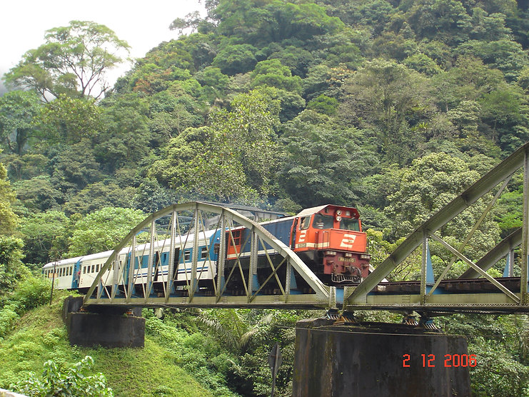 Locomotive in the Anai valley crossing a viaduct