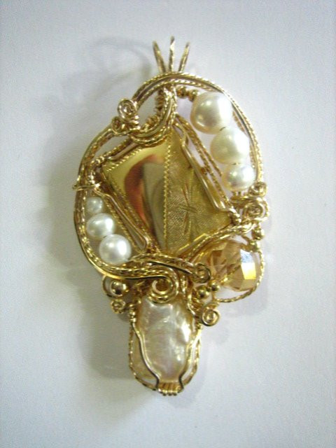 The center pat of this pendant contains her grandmothers locket