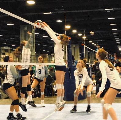 Juliette jumps for the volleyball
