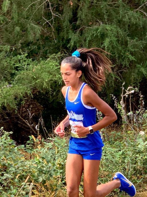 Saira runs in an invitational cross country meet