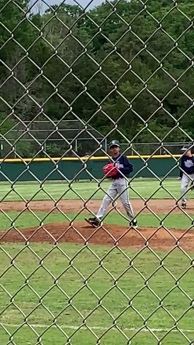 Shaan pitches during his baseball game