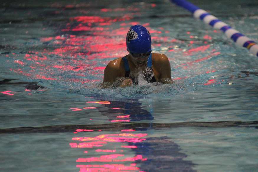 Saira swims breastroke in the finals of the Gunston District Championships