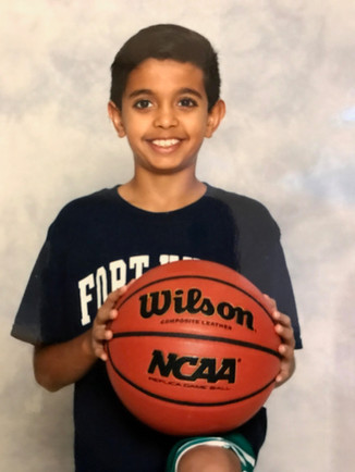 Shaan holds a basketball in his team photo