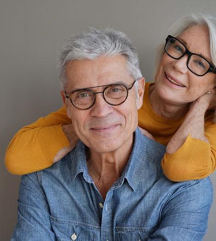 Portrait of relaxed fun senior couple w