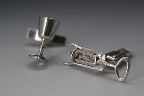 Corkscrew and wine goblet