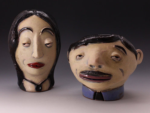 Morticia and Gomez FacePots sold as the pair