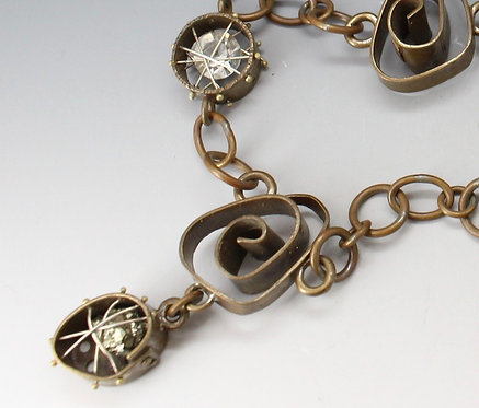 Eclectic cage and swirl necklace
