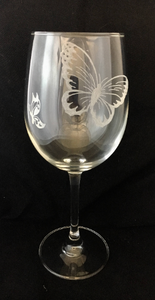 two hand engraved butterflies on wine glass