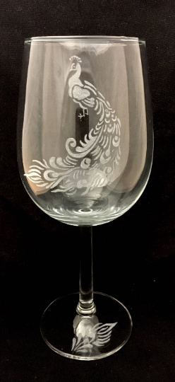 peacock engraved on to a wine glass