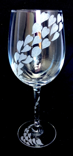 love hearts engraved around a wine glass