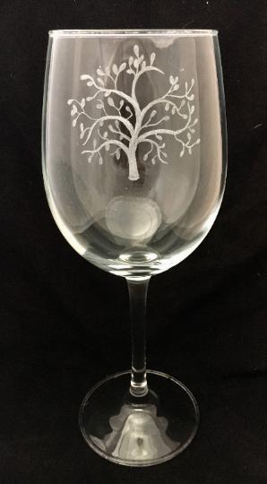 tree design engraved onto wine glass