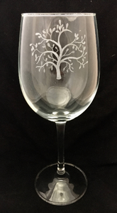 tree design engraved onto wine glass