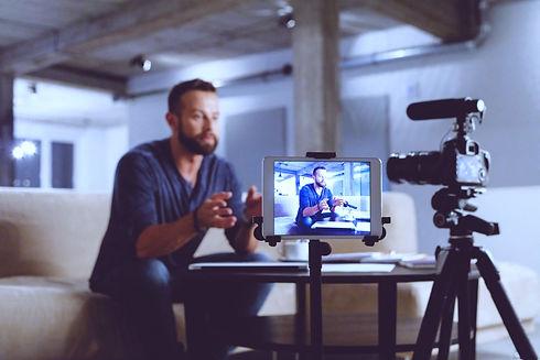 Men giving a live interview TGWT