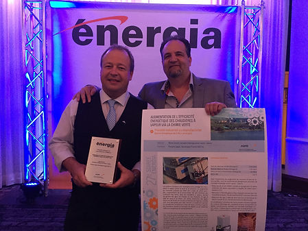"From left to right, Éric Moreau, Boiler Room Manager, Cascades Containerboard Packaging – Cabano and François Legault, Senior Representative, Water & Energy, TGWT, celebrating their second place at the AQME (Quebec's Association for Energy Advancement) Energia 2017 Competition - in the Industrial or Manufacturing Process category with an energy bill of $5 million or more per year for the project ""Increasing steam boiler energy efficiency through green chemistry"" Photos credits TGWT"