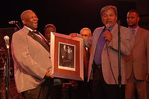 On May 1st, 2010, the great blues artist B.B. King signed a few prints of his famous photo with Elvis Presley, 'The Two Kings'. This photo shows Chief Beasley Denson of the Mississippi Choctaw Tribe presenting King with a print signed by the late photographer, Ernest Withers.