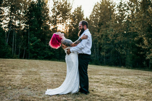 A couple laughs together in the beautiful wilderness in Washington on their adventurous wedding day, right before they say their vows and get married