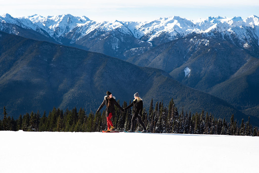 A couple snowshoeing at Hurricane Ridge for their engagement photos
