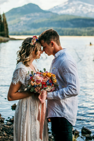 A bride and groom share an intimate moment on their hiking elopement in the pacific northwest