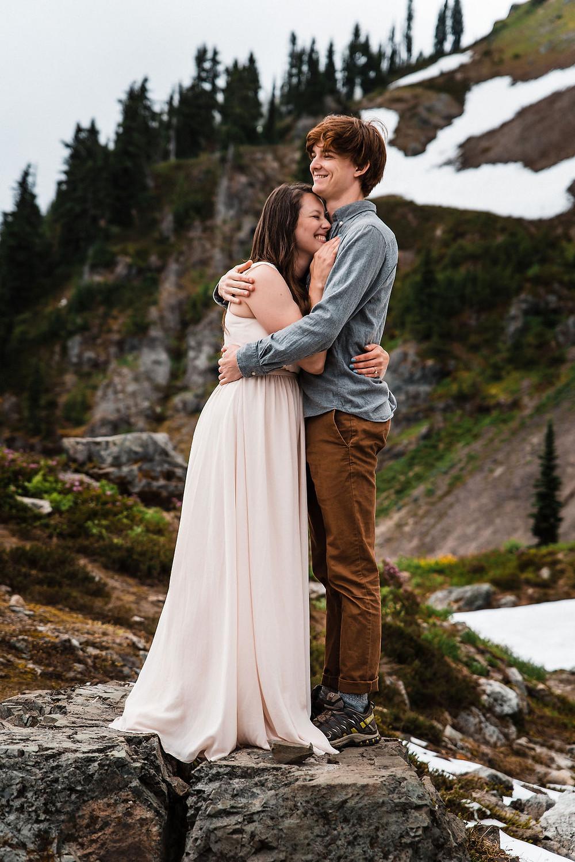 An elopement couple cuddling at their Mount Rainier elopement