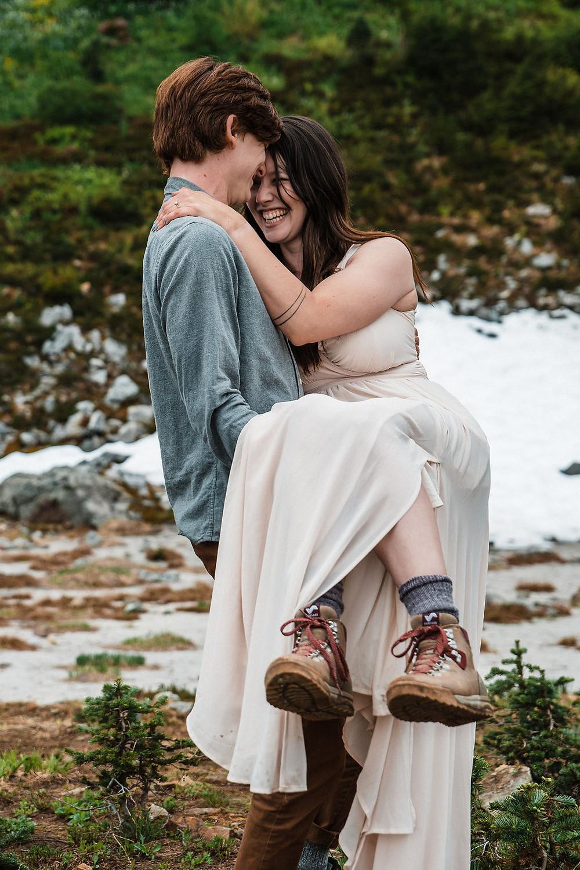 A couple having fun on their adventure elopement in Mount Rainier