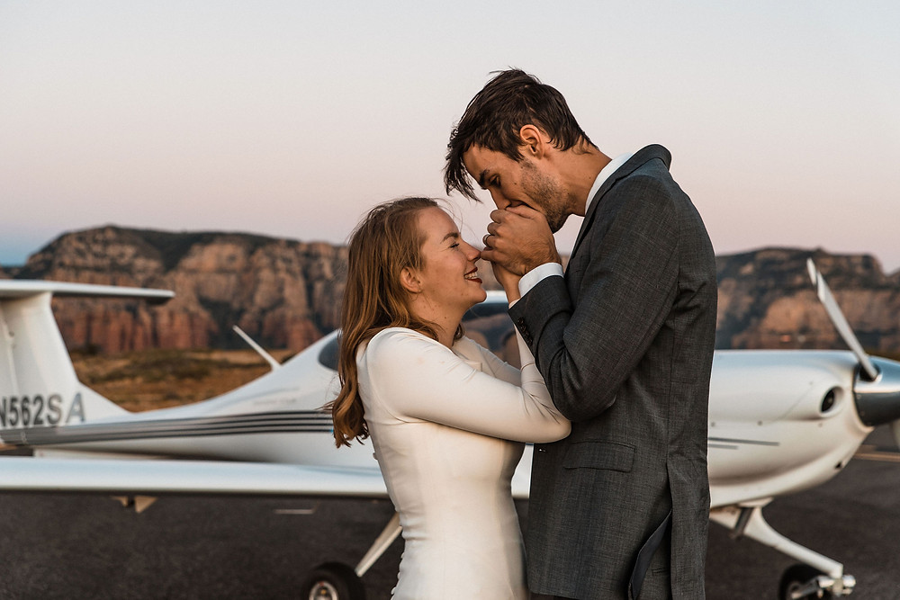 A groom warming his brides hands during their Sedona elopement