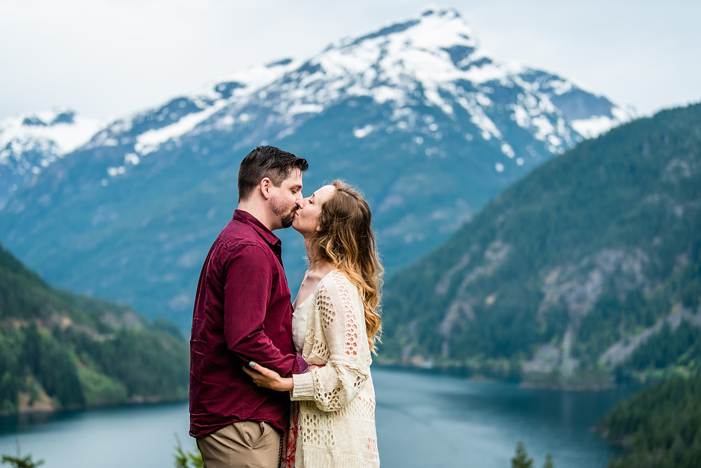 A couple on their elopement day kisses at Diablo Lake