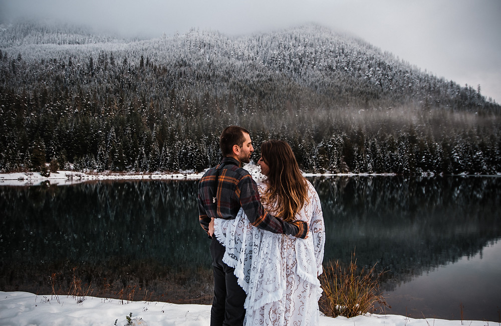 A bride and groom on their elopement day at Gold Creek Pond in Washington