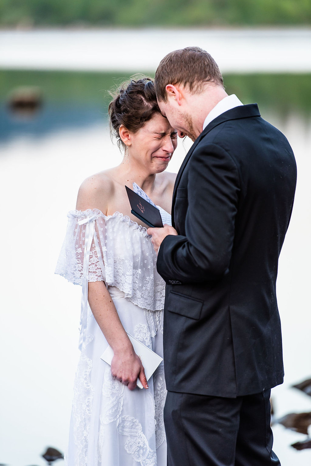 A bride cries during their elopement ceremony vows