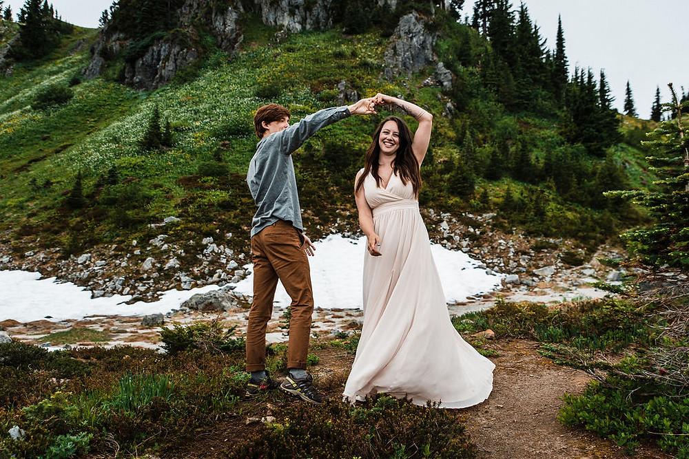 A couple having their first dance at their Mount Rainier elopement