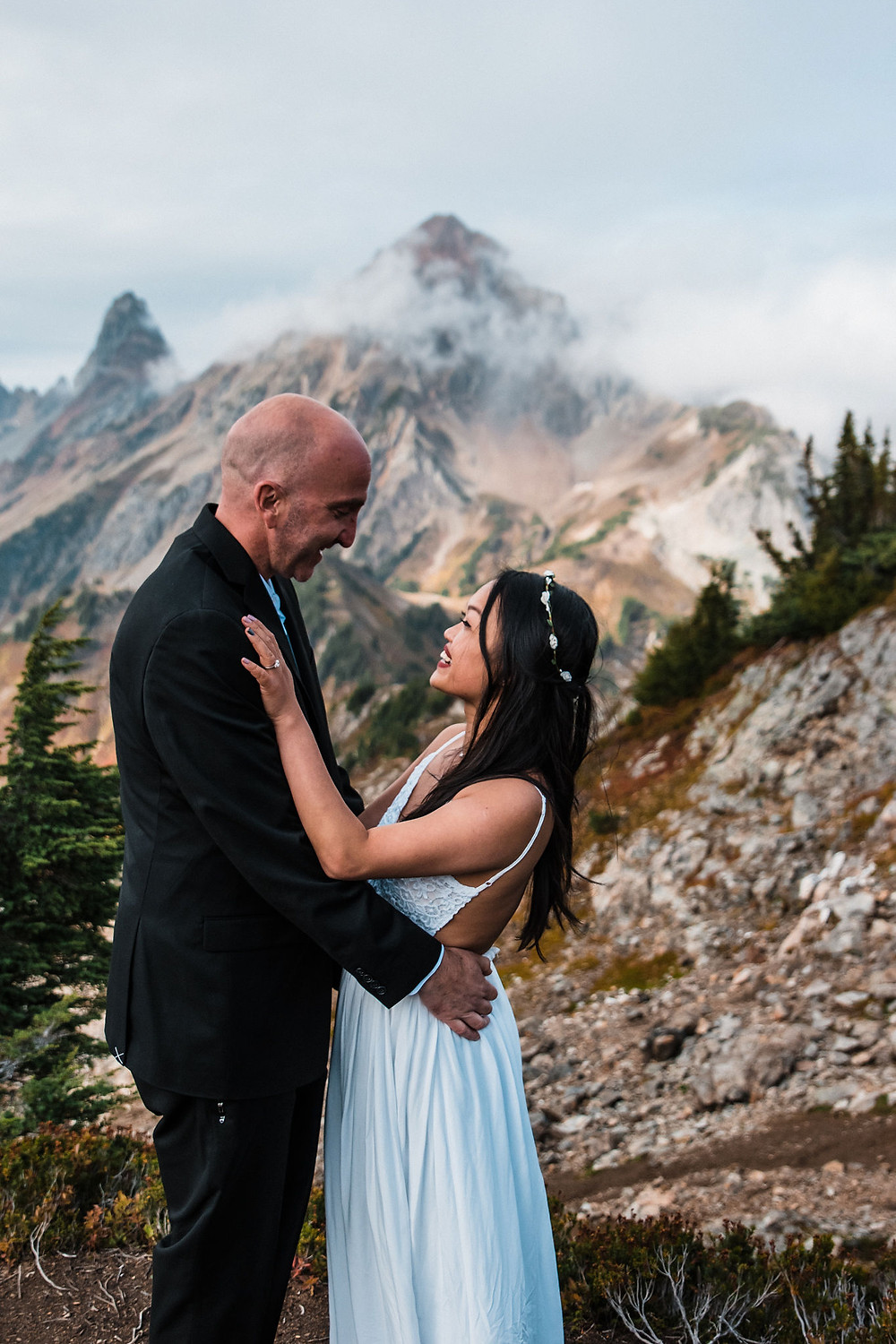 A couple smiling at one another on their adventure wedding day in the Mount Baker Wilderness